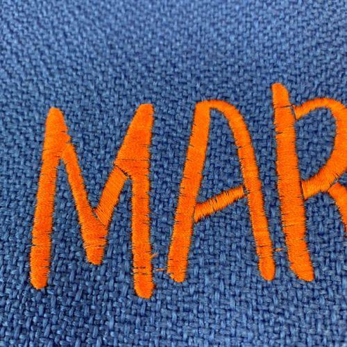 detalle bordado naranja